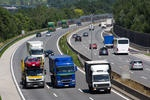 stock-photo-trucks-on-a-three-lane-motorway-symbolic-photo-for-transport-of-goods-191398322